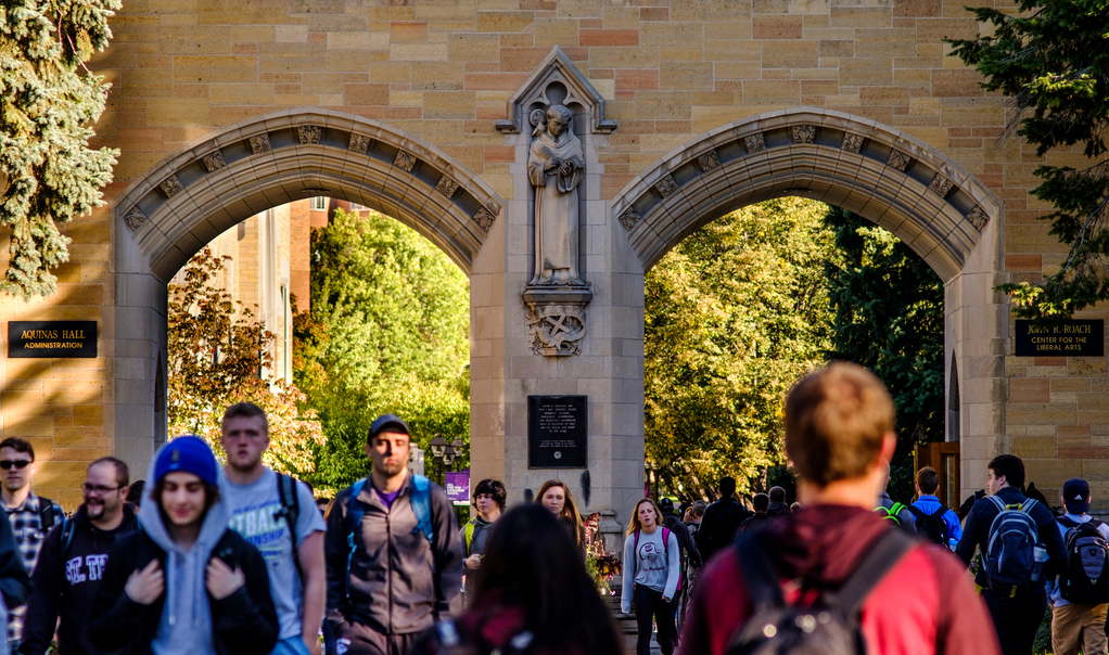 Students walk through the arches daily