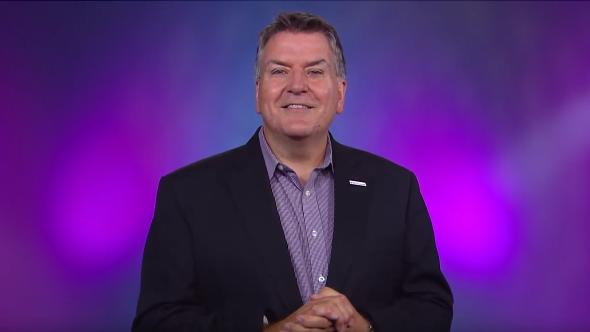 A screenshot of Joe Sullivan smiling in his welcome video