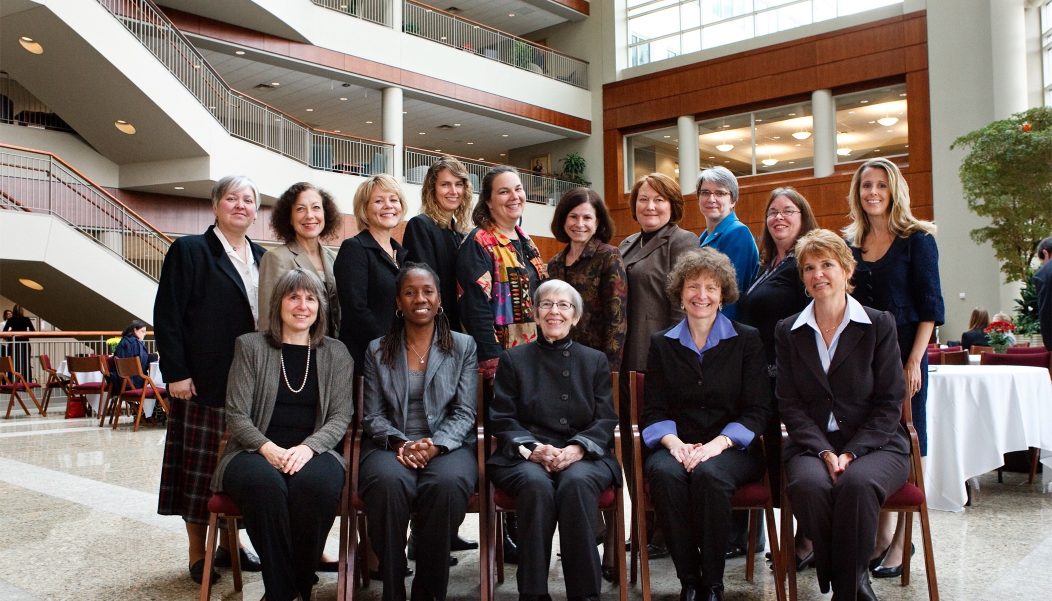 "women pose for a group photo during a ""Leadership, Gender, and Judicial Selection"" program"