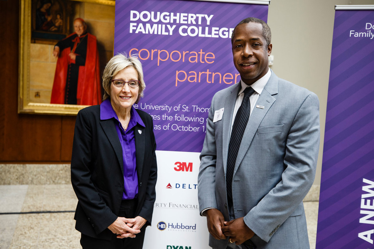 President Julie Sullivan stands with Richard Harris of U.S. Bank at a DFC event.