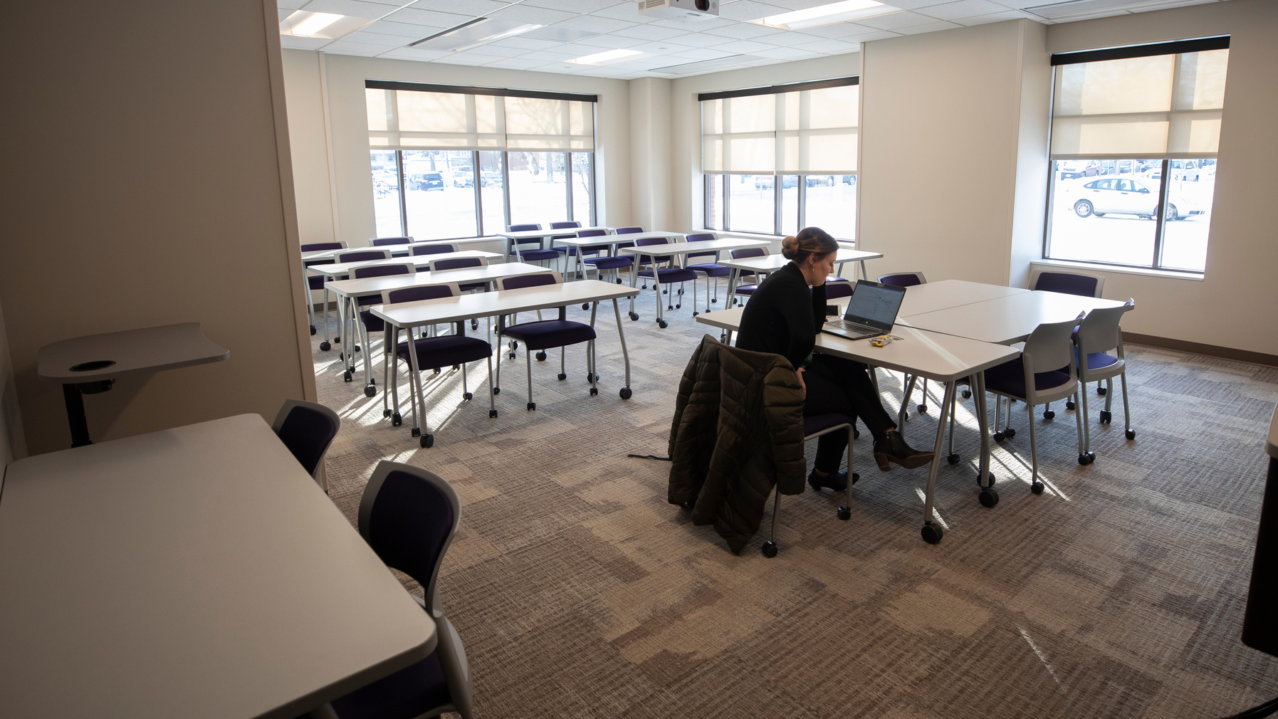 a student sits alone in a classroom in mcneely hall