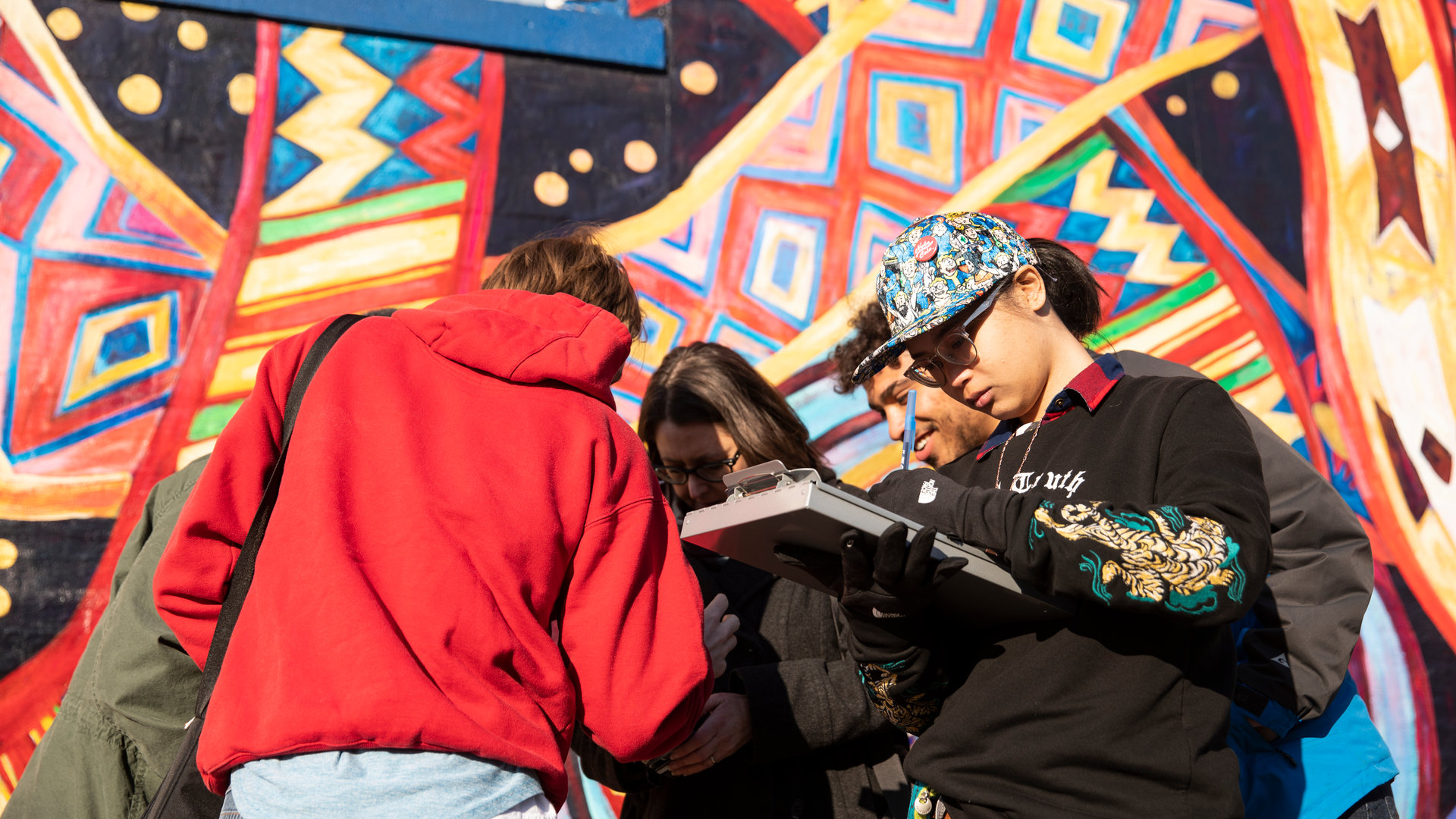 students work with professors to research and digitally map murals in the Midway neighborhood of St. Paul