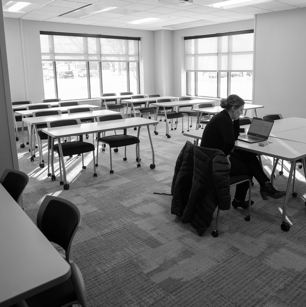 student sits alone in a room in McNeeley Hall